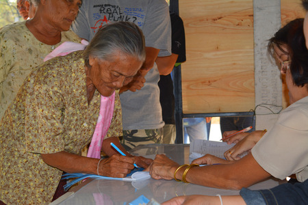voting booth: MAHASARAKHAM - JANUARY 29 : Old woman goes to vote for village headman election at Ban Nong Hin on January 29, 2015 in Muang, Mahasarakham, Thailand. Editorial