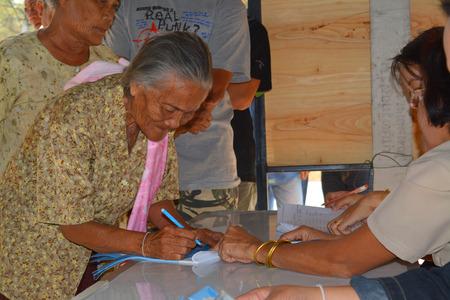 official ballot: MAHASARAKHAM - JANUARY 29 : Old woman goes to vote for village headman election at Ban Nong Hin on January 29, 2015 in Muang, Mahasarakham, Thailand. Editorial