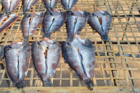 common snakehead: dried Striped snakehead fishes in market stall