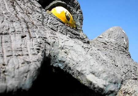 prehistory: eye of dinosaur statue in prehistory garden in Kalasin of Thailand Editorial
