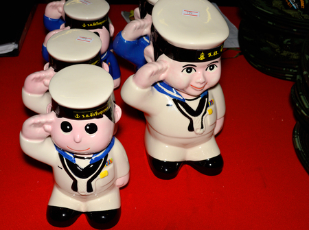 mariner: SATTAHIP, CHONBURI - SEPTEMBER 21: Mariner dolls are standing at salute and shown for sale at souvenir market zone of CVH-911or HTMS Chakri Naruebet naval base on September 21, 2014 in Sattahip, Chonburi, Thailand. Editorial