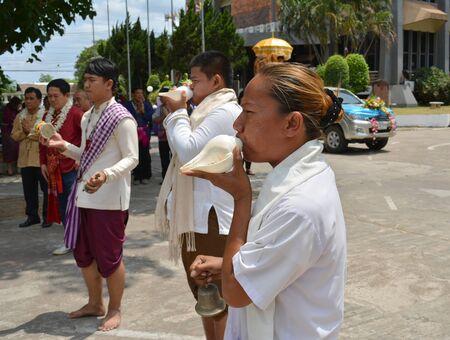 mahasarakham: MAHASARAKHAM - APRIL 12 : Priests are blowing conch and performing Brahma worship ceremony in songkran festival at Mahasarakham university on April 12, 2015 in Mahasarakham, Thailand.
