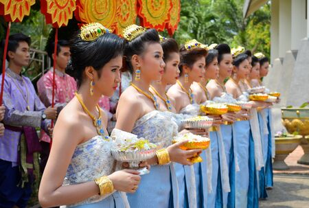 mahasarakham: MAHASARAKHAM - APRIL 12 : Students are in Buddha image procession in songkran festival at Mahasarakham university on April 12, 2015 in Mahasarakham, Thailand.