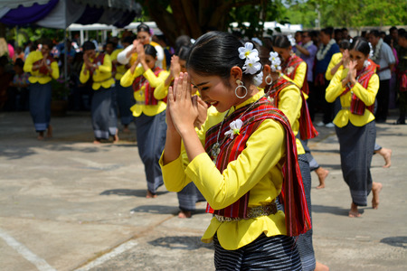 mahasarakham: MAHASARAKHAM - APRIL 12 : Women in ancient Thai costume are dancing for Buddha worship ceremony in songkran festival at Mahasarakham university on April 12, 2015 in Mahasarakham, Thailand.