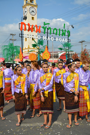 congregate: MAHASARAKHAM - APRIL 12 : Women in ancient Thai costume are assembling in songkran festival grand opening at Khao Mao road on April 12, 2015 in Mahasarakham, Thailand. Editorial