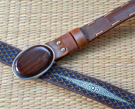 rosewood: stingray skin belt and leather belt with Siamese Rosewood buckle on a mat