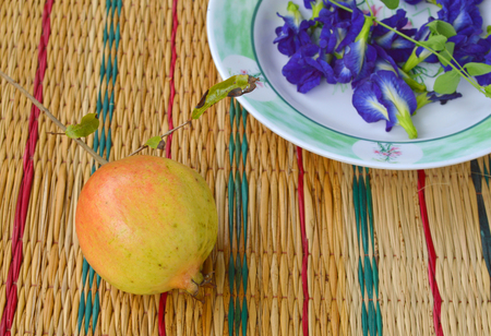 pomegranate and butterfly pea or blue pea flower photo