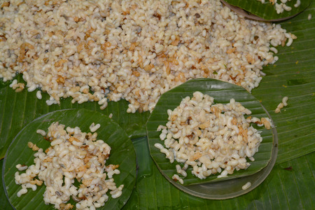 hexapoda: red ant egg on banana leaf at wild food market in Northeast Thailand