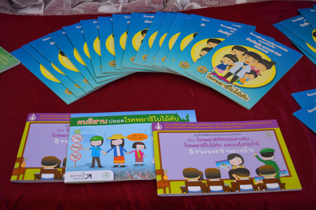 instructional: MAHASARAKHAM  JUNE 20 : Instructional media books of opisthorchis viverrini protection are on display in health assembly seminar at Padung Nari school on June 20 2015 in Mahasarakham Thailand.
