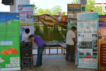 fish exhibition: MAHASARAKHAM  JUNE 20 : Spectators are  looking instructional media of opisthorchis viverrini protection in health assembly seminar at Padung Nari school on June 20 2015 in Mahasarakham Thailand.