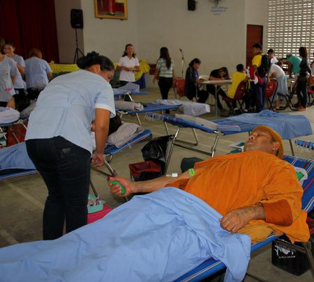 PAYAKKAPHUMPHISAI MAHASARAKHAM  JUNE 23 : Buddhist monk is making blood donation at city hall on June 23 2015 in Payakkaphumphisai Mahasarakham Thailand.