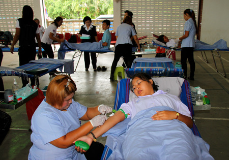 mahasarakham: PAYAKKAPHUMPHISAI MAHASARAKHAM  JUNE 23 : Blood donors are making donation at city hall on June 23 2015 in Payakkaphumphisai Mahasarakham Thailand.