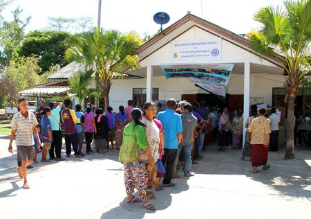 voting booth: PAYAKKAPHUMPHISAI MAHASARAKHAM  JUNE  28 : Villagers go to vote for representative of the office of farmers reconstruction and development fund on June 28 2015 in Payakkaphumphisai Mahasarakham Thailand.
