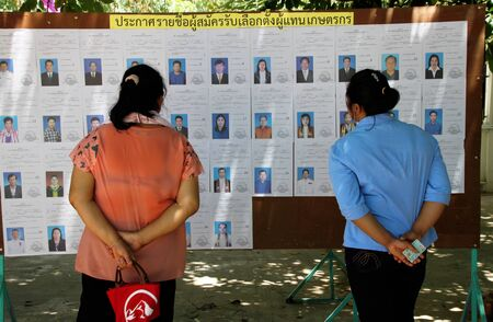 official ballot: PAYAKKAPHUMPHISAI  JUNE  28 : Villagers check candidate name for representative of farmers reconstruction and development fund on June 28 2015 in Payakkaphumphisai Mahasarakham Thailand.