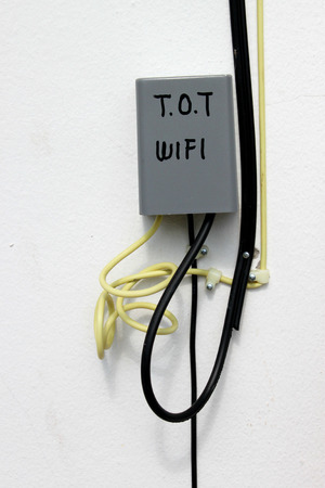 tot: MAHASARAKHAM - NOVEMBER 8 : T.O.T. wifi and network electrical cables are installed at district hall on November 8, 2013 in Mahasarakham, Thailand.
