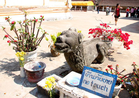 ing: SAVANNAKHET, LAO P.D.R. - FEBRUARY 7 : Lion statue and no touch sign at Ing Hang Stupa on February 7, 2015 in Savannakhet, Lao P.D.R. Editorial