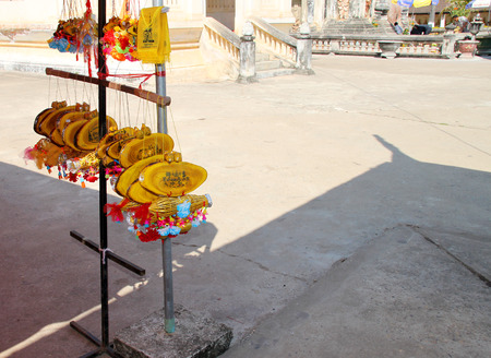 ing: SAVANNAKHET, LAO P.D.R. - FEBRUARY 7 : Amulet objects and talismans for sale at Ing Hang Stupa on February 7, 2015 in Savannakhet, Lao P.D.R.
