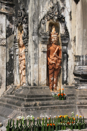 lao: Buddhism statue at Ing Hang Stupa in Savannakhet of Lao P.D.R.