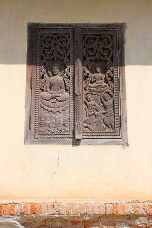 ing: old wooden window at Ing Hang Stupa in Savannakhet of Lao P.D.R.