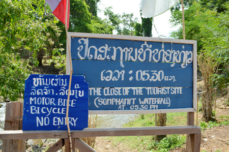 det: CHAMPASAK, LAO P.D.R. - MAY 12 : Warning sign and the close of tourist site sign are installed at Somphamit Fall at Don Det village on May 12, 2013 in Champasak, Lao P.D.R. Editorial