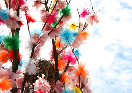 bird nest: bird nest and blossom flowers on tree made from clothes