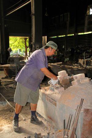 laborer: BANGKOK - AUGUST 20 : Laborer is working at Makkasan workshop, the biggest railway repairing site of country on August 20, 2015 in Bangkok, Thailand. Editorial