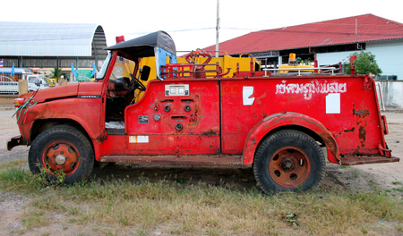 PAYAKKAPHUMPHISAI, MAHASARAKHAM - August 25 : Old municipality firetruck is dropped off at parking lots because of decadence on August 25, 2015 in Payakkaphumphisai, Mahasarakham, Thailand. Editorial