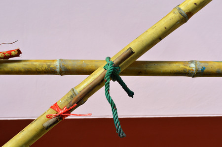 tightly: Thai folk wisdom of how to tie rope tightly in building construction site