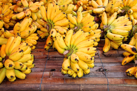 dainty: Dainty bananas for retail sale in local fruits market of Thailand Stock Photo