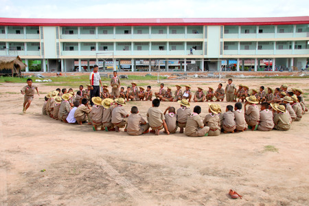scouts: PAYAKKAPHUMPHISAI, MAHASARAKHAM - SEPTEMBER 3 : Children scouts are playing game and sport at public Anuban school on September 3, 2015 in Payakkaphumphisai, Mahasarakham, Thailand.