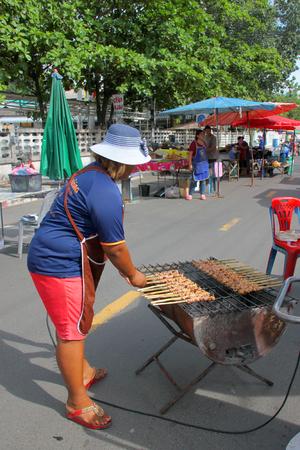 entrails: PAYAKKAPHUMPHISAI, MAHASARAKHAM - SEPTEMBER 3 : Vendor woman is selling barbecue entrails chicken at market stall on September 3, 2015 in Payakkaphumphisai, Mahasarakham, Thailand. Editorial