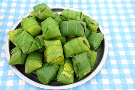 tightly: pork, shredded and salted, bound tightly with banana leaves, and eaten slightly fermented