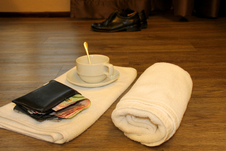money purse and towel on wooden floor in the morning light room