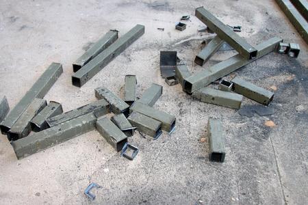 scrap iron: piece of cut metal on concrete floor