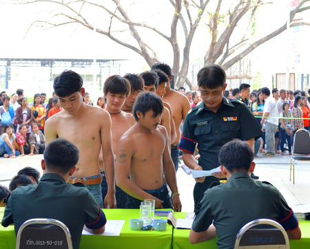 conscription: MAHASARAKHAM, THAILAND - APRIL 9 : Thai young men are in soldiers recruitment process on April 9, 2014 in Serm Thai Complex, Muang, Mahasarakham, Thailand.
