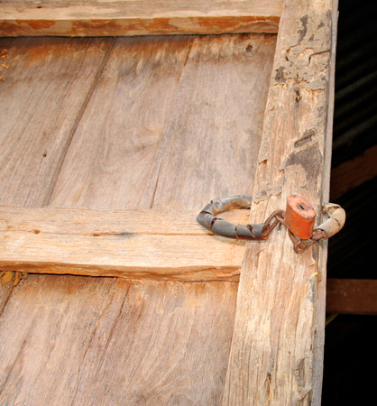 termite damage home wooden wall and master key