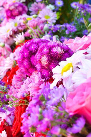 globosa: Gomphrena globosa Linn. in wreath of mixed flowers Stock Photo