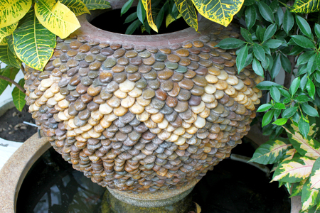 ornamental garden: stone plant pot in ornamental garden Stock Photo