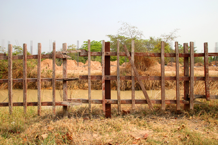 enclose: wooden fence surround building site Stock Photo