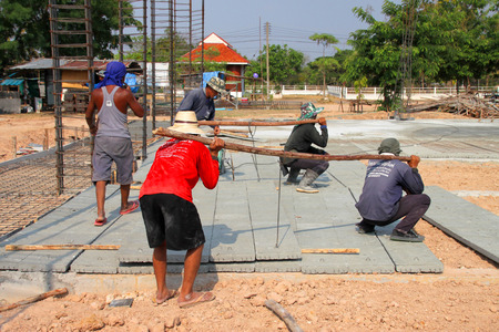 YANGSRISURAT, MAHASARAKHAM - APRIL 25 : Laborers work in construction site on April 25, 2016 in Yangsrisurat, Mahasarakham, Thailand.
