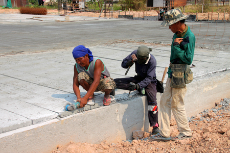 the unskilled worker: YANGSRISURAT, MAHASARAKHAM - APRIL 26 : Laborers work in construction site on April 26, 2016 in Yangsrisurat, Mahasarakham, Thailand.