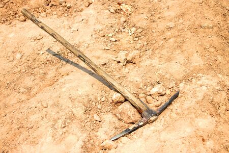 mattock: pickaxe deserted on the ground