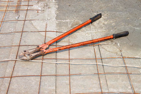 stone cutter: big pliers cutting deserted on concrete floor Stock Photo