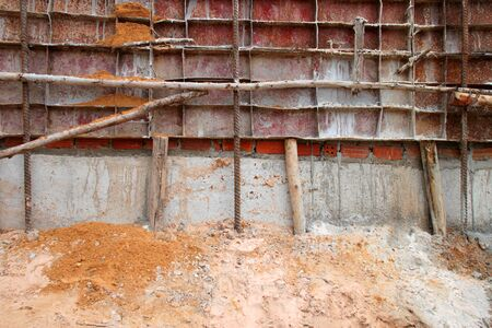 compacted: metal form work in building site Stock Photo