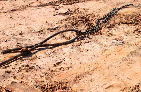 building a chain: metal sling and chain at building site