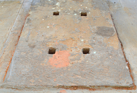 sanitary: manhole cover of sanitary sewer drainage pipe under footpath Stock Photo