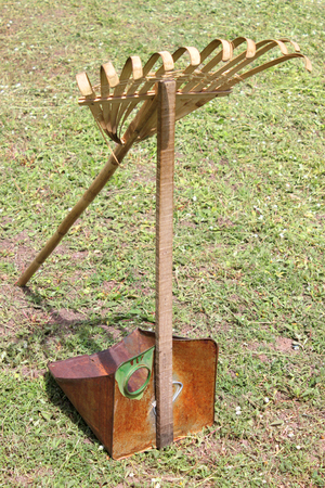 harrow: old harrow and dust pan on the play ground