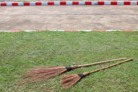 play ground: old coconut-palm leaf stalk broom on the play ground Stock Photo