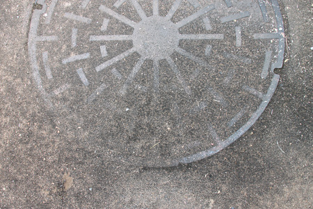 manhole: old and grunge metal manhole cover on the ground Stock Photo