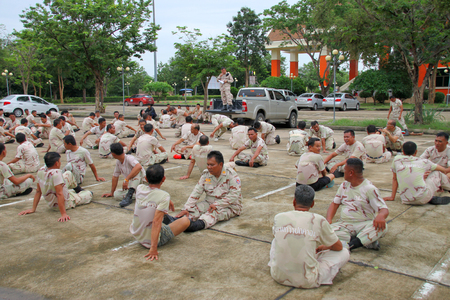 situp: MAHASARAKHAM - JULY 5 : Members of Volunteer Defense Corps are annual physical fitness tested at provincial city hall on July 5, 2016 in Mahasarakham, Thailand. Editorial